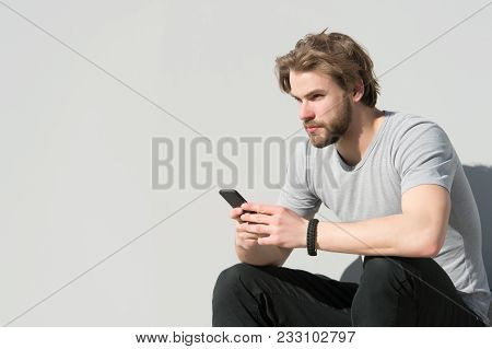 Man Sit With Smartphone On