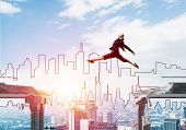 Business Woman Jumping Over Gap In Concrete Bridge As Symbol Of Overcoming Challenges. Cityscape And poster