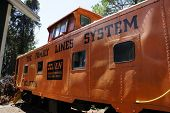 pic of caboose  - Picture of a historic orange caboose at a museum - JPG