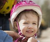 Little Girl In A Bicycle Helmet