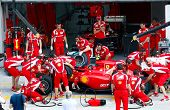 SEPANG, MALAYSIA - APRIL 8: Scuderia Ferrari F1 Team pit crew practice tire change in the pit-lane o