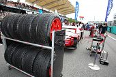 SEPANG - JUNE 19: Lexus Team Sard's pit crew puts the rain tires on standby at the start of the Japa