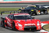 SEPANG, MALAYSIA - JUNE 19: The Nissan GTR car of the NISMO team accelerates into turn 2 of the Sepa