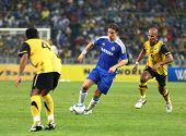 BUKIT JALIL, MALAYSIA - JULY 21: Chelsea's Fernando Torres (blue) leads the attack in this match aga