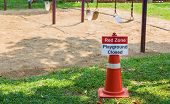 Red Zone Playground Closed Sign Posting At A Children Playground During High Air Pollution Season In poster
