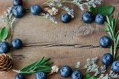 Beautiful Vintage Background Or Wallpaper Frame Of Fresh Wild Blueberries On Wood Plank. Blueberry B poster