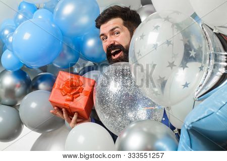 poster of Happy Birthday Man With Helium Balloons Holds Gift Box. Festive Event Or Birthday Party. Happy Beard