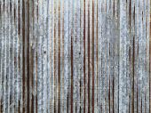 Old Rusty Galvanized, Corrugated Iron Siding Texture Background.a Rusty Corrugated Iron Metal Textur poster