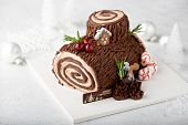 Christmas Yule Log Cake With Edible Sweet Mushrooms And Pine Cones poster