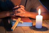 Religious Christian Child  Praying Over Bible Indoors, Religious Concepts poster