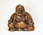 Smiling Buddha Statue On White Background. The Wooden Statue Of Buddha. poster