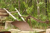 picture of horse plowing  - A rust covered antique one share horse drawn plow - JPG