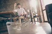 Full Length Photo Of Frustrated Middle Eastern Entrepreneur Sit Chair Throw Crumpled Paper In Dustbi poster