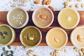 Nuts And Seeds Butter In Jars With Ingredients. Homemade Raw Organic Peanut, Almond, Hazlenut, Cashe poster