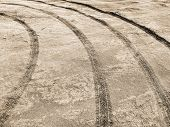 Tyre Track On Dirt Sand Or Mud, Retro Tone, Grunge Tone, Drive On Sand, Off Road Track. Wheel Tracks poster