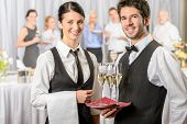 stock photo of buffet lunch  - Professional catering service business event serving drinks to guests - JPG