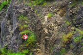 Steel net for protection against rock slide - Metal net background on the mountain wall poster