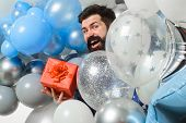 Happy Birthday Man With Helium Balloons Holds Gift Box. Festive Event Or Birthday Party. Happy Beard poster