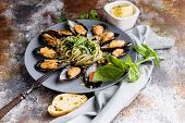 Delicious Seafood Pasta. Fresh Mussels And Pesto Pasta. Mediterranean Kitchen. poster