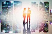 Two Young Businessmen Shaking Hands In Night City With Double Exposure Of Big Data Interface. Toned  poster