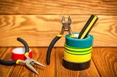 Three Insulating Tape For Electrician On Wooden Boards poster