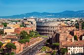 stock photo of cross hill  - Ariel view of The Colosseum in Rome - JPG