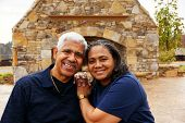 picture of senior-citizen  - Happy senior couple together outside their home - JPG