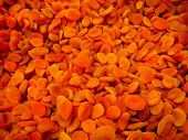 Pile Of Dried Apricots Pattern Background In Fruit Market Lined For Sale. Heap Of Sweet Apricots In  poster