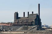 The Last Of The Rust Belt Steel Mills In Cleveland, Ohio With Large Mounds Of Coke And Coal Used In  poster