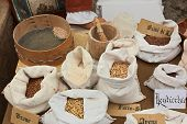 picture of flour sifter  - reproduction of old grain store whit assortment of cereals legumes and flour  - JPG