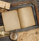 image of treasure  - Open diary top view with old treasure map and compass - JPG