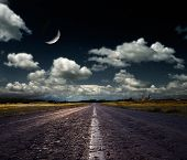 stock photo of blue moon  - country road leading to the church - JPG