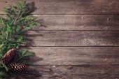 stock photo of fir  - christmas fir with cone on wooden background - JPG