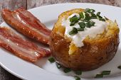 baked potato filled with sour cream and bacon
