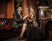 Elegant well-dressed couple in luxury interior