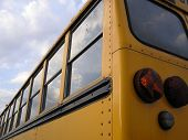 foto of bus driver  - the back corner of a yellow school bus after dropping off children after a school day - JPG