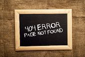 pic of not found  - 404 error internet web page not found message on the blackboard - JPG