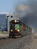stock photo of bnsf  - a southbound manifest train picks up speed on its way out of chewelah - JPG