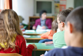 foto of school child  - Kids in classroom studying photographed from behind - JPG