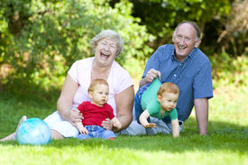 foto of grandparent child  - Playing with redheaded twin grandsons with focus on laughing grandparents - JPG