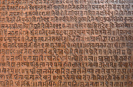 stock photo of sanskrit  - background with ancient sanskrit text etched into a stone tablet in a public square - JPG