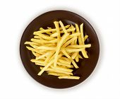 a pile of french fries isolated in black plate on white