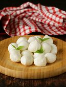 small balls mozzarella cheese with basil leaves