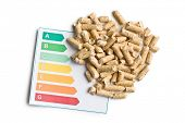 wooden pellets and energy efficiency levels on white background