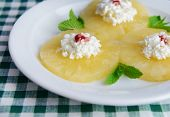 Tasty pineapple with cottage cheese, close up
