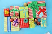 Many colorful presents with luxury ribbons  on color  background