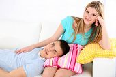 Loving couple sitting on sofa, on home interior background