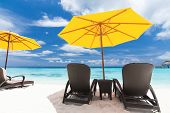 image of beachfront  - Tropical beach with sun umbrellas - JPG
