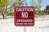 picture of lifeguard  - Warning sign on the beach no lifeguard - JPG
