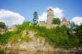 Medieval castle Zvikov in the Czech Republic with round tower, draw-bridge and blue sky seen from th